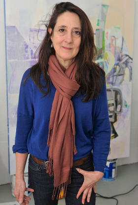 Laurie Danial in front of one of her paintings.