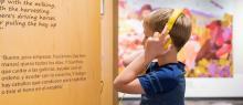 A multi-lingual interpretive exibit at Five Oaks Museum, accompanied by audio description.